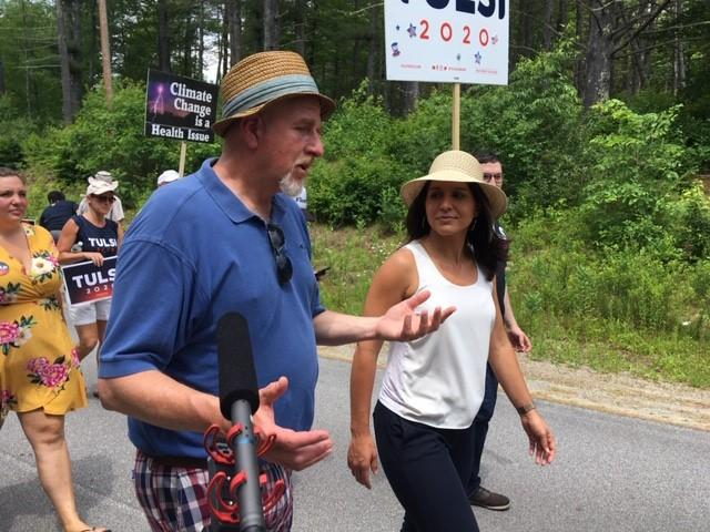 Congresswoman Tulsi Gabbard marches with state Rep. Tim Egan at Franconia's July 4th parade